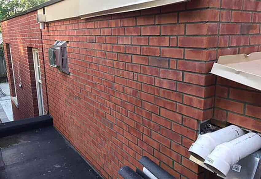 Brick veneer, tuck pointing